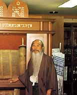 Japanese calligrapher master Kampo Harada, who believes himself to be of the Zevulun tribe, in front of the ark in his Kyoto home